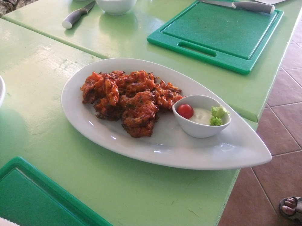 Tomato Fritters served with a yogurt & mint dipping sauce.