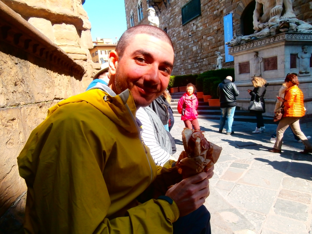 enjoying a sandwich in the Piazza della Signoria in Florence