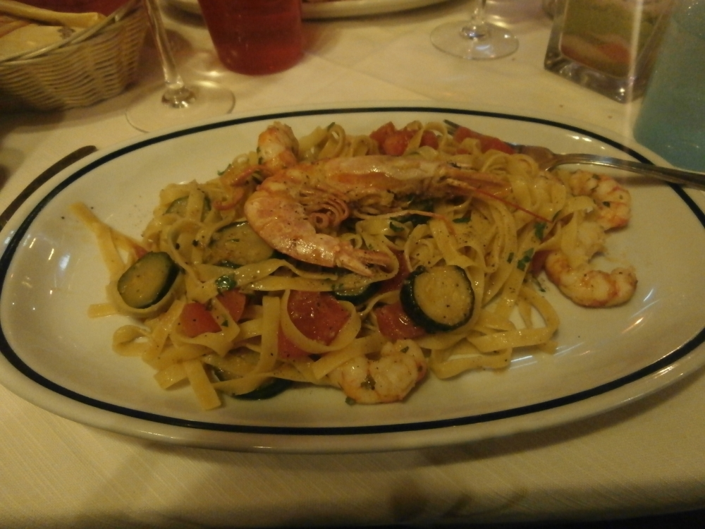 Tagliatelle pasta with prawns and zucchini in Venice.